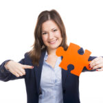 job fit-business woman holding puzzle piece